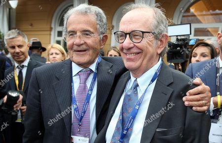 Former Italian Premier Romano Prodi (L) and former Italian Economy Minister Pier Carlo Padoan (R) attend the Forum The European House - Ambrosetti, in Cernobbio, northern Italy, 06 September 2019.
