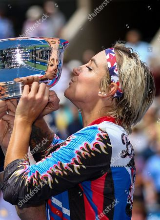 Bethanie Mattek-Sands of USA kisses the Mixed Doubles trophy after winning Mixed Doubles with Jamie Murray of Great Britain