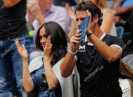 Meghan Duchess of Sussex, applauds alongside Patrick Mouratoglou during the Women's Final