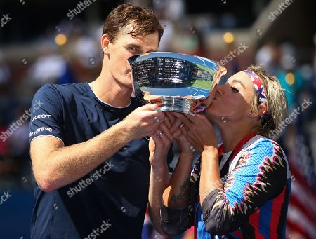 Jamie Murray of Great Britain and Bethanie Mattek-Sands of USA kiss the Mixed Doubles trophy