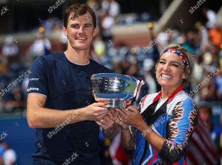 Jamie Murray of Great Britain and Bethanie Mattek-Sands of USA lift the Mixed Doubles trophy