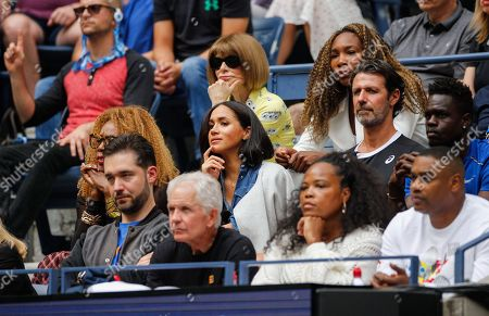 Meghan Duchess of Sussex, Meghan Duchess of Sussex, sits in the centre of Serena Williams Royal Box alongside Alexis Ohanian, Isha Price, Oracene Price, Patrick Mouratoglou, Anna Wintour and Venus Williams during the Women's Final