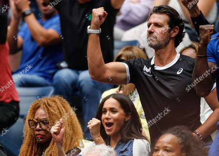 Meghan Duchess of Sussex, and Patrick Patrick Mouratoglou cheer during the Women's Final
