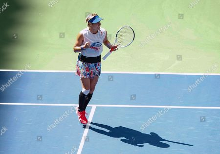 Bethanie Mattek-Sands of USA celebrates as she wins the Mixed Doubles Final with Jamie Murray of Great Britain