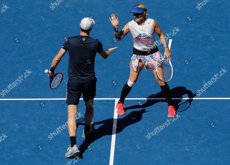 Jamie Murray of Great Britain and Bethanie Mattek-Sands of USA high-five during play in the Mixed Doubles Final
