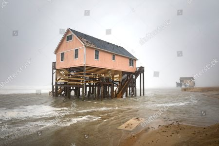 Water from the Atlantic Ocean flows beneath beach homes as Hurricane Dorian hits Nags Head, North Carolina, USA, 06 September 2019. The Category 1 storm struck the state's fragile barrier islands, the Outer Banks, for much of the day.