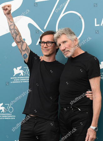 Roger Waters, Sean Evans. Musician Roger Waters, right, and director Sean Evans pose for photographers at the photo call for the film 'Roger Waters Us + Them' at the 76th edition of the Venice Film Festival in Venice, Italy