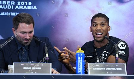 British heavyweight boxer Anthony Joshua (R) with promoter Eddie Hearn (L) attend a press conference in west London, Britain, 06 September 2019. Joshua is set to fight World Heavyweight champion Andy Ruiz from Mexico in a world heavyweight title rematch in Saudi Arabia on 07 December 2019.