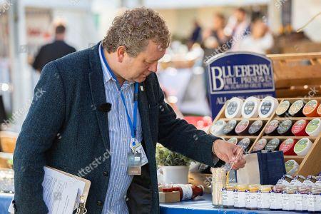 Jon Culshaw judges food stall at the Trials.