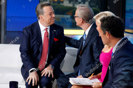 "Stock Photo of Ed Henry, Steve Doocy, Ainsley Earhardt, Brian Kilmeade. Fox News Chief National Correspondent Ed Henry, left, gets emotional as he describes his surgery to co-hosts Steve Doocy, second left, Ainsley Earhardt, and Brian Kilmeade on the ""Fox & friends"" television program, in New York, . Henry retuned after donating 30-percent of his liver to his ailing sister"
