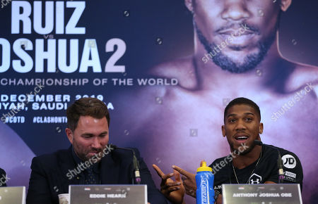 Anthony Joshua jokes with Eddie Hearn  during the press conference