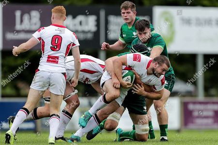 Ulster vs Connacht Eagles. Ulster's Peter Cooper is tackled by Joe Maksymiw and Dylan Tierney-Martin of the Connacht Eagles