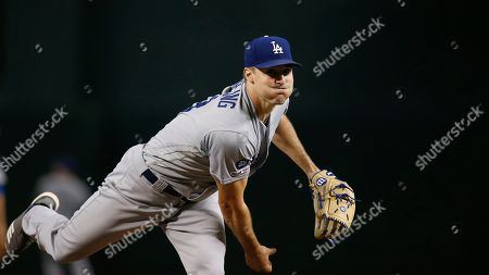 Los Angeles Dodgers starting pitcher Ross Stripling warms up during the first inning of a baseball game against the Arizona Diamondbacks, in Phoenix