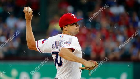 Texas Rangers starting pitcher Brock Burke works against the Seattle Mariners in a baseball game in Arlington, Texas