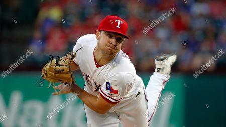 Texas Rangers' Brock Burke works against the Seattle Mariners in a baseball game in Arlington, Texas