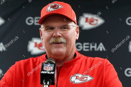 "Kansas City Chiefs coach Andy Reid speaks at a news conference after the team's preseason NFL football game against the Pittsburgh Steelers in Pittsburgh. ""Modern Family"" star Eric Stonestreet plays the part of the bumbling younger brother of Reid in a new spoof video that was released in advance of the first game of the regular season"