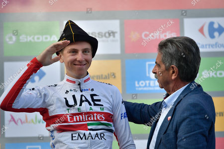 Tadej Pogacar, Miguel Angel Revilla. UAE Emirates' Team Tadej Pogacar of Slovenia, left, celebrates on the podium wearing a regional beret beside Regional President Miguel Angel Revilla after winning the stage at the end of the 13th stage between Bilbao-Los Machucos Monumento Vaca Pasiega, 166,4 km kilometers (103,39miles), of the Spanish Vuelta cycling race that finishes Los Machucos, near to San Roque de Riomera, northern Spain