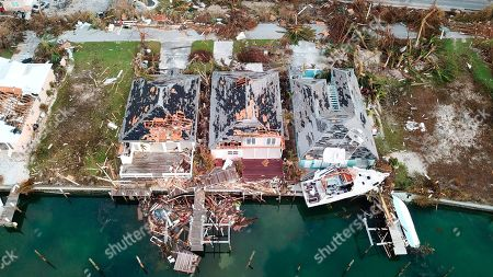Destruction caused by Hurricane Dorian is seen from the air, in Marsh Harbor, Abaco Island, Bahamas, . The Bahamian health ministry said helicopters and boats are on the way to help people in affected areas, though officials warned of delays because of severe flooding and limited access
