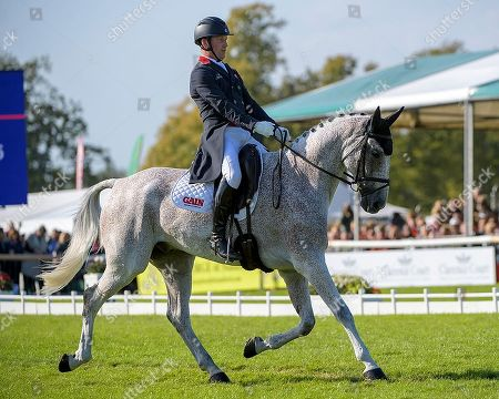 Oliver Townend (GBR) riding Ballaghmor Class in action. In second place after the Dressage Phase.