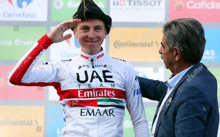 Slovenian rider Tadej Pogacar (L) of the UAE Team Emirates celebrates on the podium after winning the 13th stage of the Vuelta a Espana cycling race over 166.4km from Bilbao to Los Machucos, northern Spain, 06 September 2019.  At right Cantabria's regional president Miguel Angel Revilla.