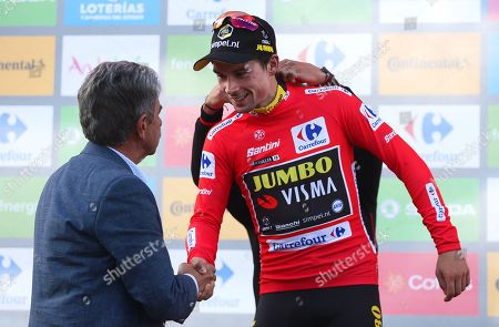 Slovenian rider Primoz Roglic (R) of Team Jumbo-Visma is congratulated by Cantabria's regional president Miguel Angel Revilla (L) on the podium after retaining the overall leader's red jersey following the 13th stage of the Vuelta a Espana cycling race over 166.4km from Bilbao to Los Machucos, northern Spain, 06 September 2019.