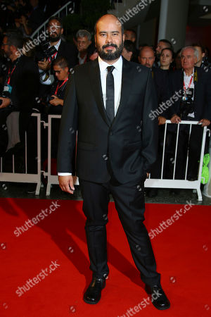 Ciro Guerra poses for photographers upon arrival at the premiere of the film 'Waiting for the Barbarians' at the 76th edition of the Venice Film Festival, Venice, Italy