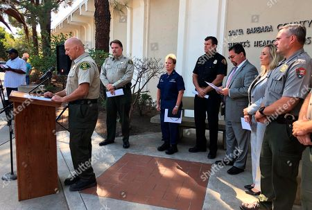 Santa Barbara County Sheriff Bill Brown, at podium, announces that 18 people killed in the California dive boat fire have been positively identified, at a news conference at Sheriff's headquarters in Santa Barbara, Calif., Other identifications require DNA analysis because of the intensity of the fire early Monday, Sept. 2 aboard the vessel Conception