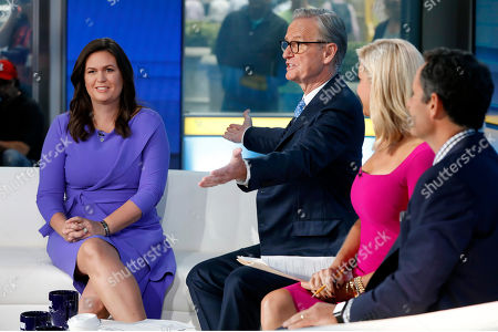 "Stock Picture of Sarah Huckabee Sanders, Steve Doocy, Ainsley Earhardt, Brian Kilmeade. Fox News contributor Sarah Huckabee Sanders, left, is introduced by co-host Steve Doocy, second left, for her initial appearance on the ""Fox & friends"" television program, in New York . Seated at right are show co-hosts Ainsley Earhardt and Brian Kilmeade. Sanders has been hired to provide political commentary and analysis across all Fox News properties, including Fox News Channel, Fox Business Network and the radio and podcast division"