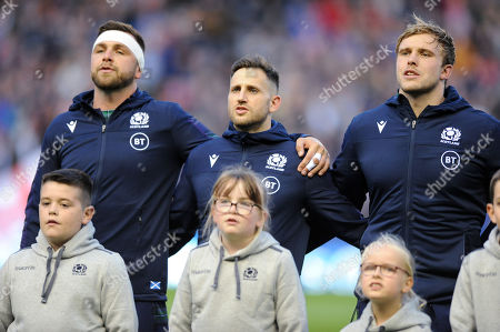 (L to R) Ryan Wilson (captain), Tommy Seymour and Jonny Gray - Scotland players line up for the national anthem.