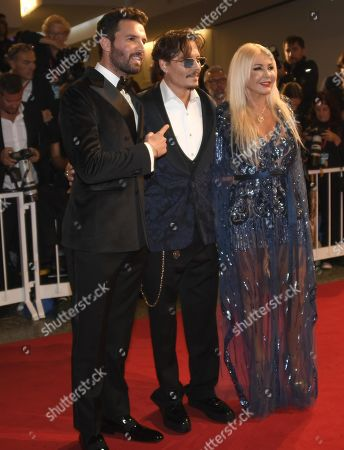Johnny Depp (C), and Italian producers Monika Bacardi (R) and Andrea Iervolino (L) arrive for the premiere of 'Waiting for the Barbarians' during the 76th annual Venice International Film Festival, in Venice, Italy, 06 September 2019. The movie is presented in the official competiton 'Venezia 76' at the festival running from 28 August to 07 September.