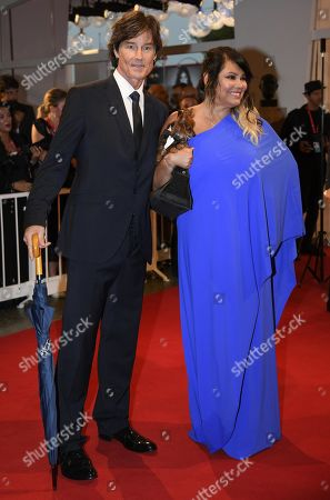 Devin DeVasquez (R) and US actor Ronn Moss (L) arrive for the premiere of 'Waiting for the Barbarians' during the 76th annual Venice International Film Festival, in Venice, Italy, 06 September 2019. The movie is presented in the official competiton 'Venezia 76' at the festival running from 28 August to 07 September.