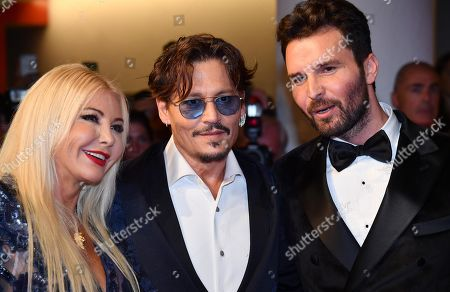 Johnny Depp (C), Italian producers Monika Bacardi (L) and Andrea Iervolino (R) arrive for the premiere of 'Waiting for the Barbarians' during the 76th annual Venice International Film Festival, in Venice, Italy, 06 September 2019. The movie is presented in the official competiton 'Venezia 76' at the festival running from 28 August to 07 September.