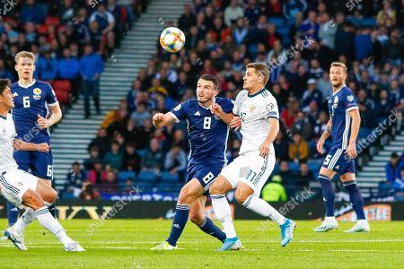 John McGinn (Aston Villa) & Aleksandr Golovin (Monaco) challenge for the ball during the UEFA European 2020 Qualifier match between Scotland and Russia at Hampden Park, Glasgow