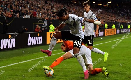 Germany's Serge Gnabry (L) in action with Netherlands' Daley Blind (C) during the UEFA EURO 2020 qualifiers group C soccer match between Germany and the Netherlands in Hamburg, Germany, 06 September 2019.