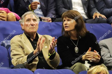 Judd Hirsch, left, watches play between Daniil Medvedev, of Russia, and Grigor Dimitrov, of Bulgaria, during the men's singles semifinals of the U.S. Open tennis championships, in New York