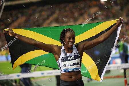 Jamaica's Danielle Williams celebrates after winning the Women's 100m Hurdles during the Diamond League Memorial Van Damme athletics event at the King Baudouin stadium in Brussels