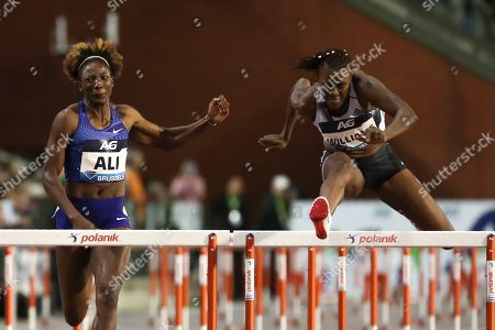Jamaica's Danielle Williams, right, competes to win the Women's 100m Hurdles during the Diamond League Memorial Van Damme athletics event at the King Baudouin stadium in Brussels