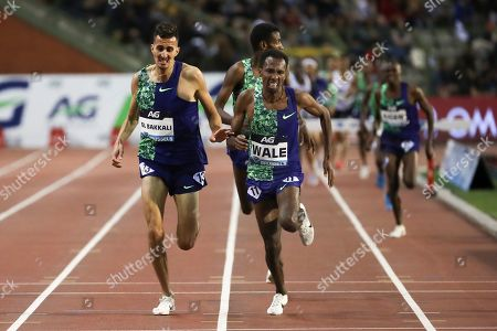 Ethiopia's Getnet Wale, right, competes to win Men's 3000 steeplechase during the Diamond League Memorial Van Damme athletics event at the King Baudouin stadium in Brussels