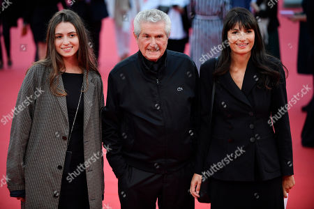 Claude Lelouch (C) and his wife Valerie Perrin (R) arrive with a guest on the red carpet prior to the opening ceremony during the 45th Deauville American Film Festival, in Deauville, France, 06 September 2019. The festival runs from 06 to 15 September 2019.