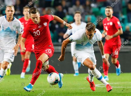Poland's Piotr Zielinski (L) in action against Slovenia's Jure Balkovec (R) during the UEFA EURO 2020 group G qualifying soccer match between Slovenia and Poland at Stozice stadium in Ljubljana, Slovenia, 06 September 2019.