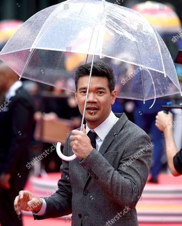 """Destin Daniel Cretton carries an umbrella as he attends the premiere for """"Just Mercy"""" on day two of the Toronto International Film Festival at the Roy Thomson Hall, in Toronto"""