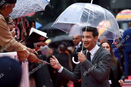 """Destin Daniel Cretton signs autographs as he attends the premiere for """"Just Mercy"""" on day two of the Toronto International Film Festival at the Roy Thomson Hall, in Toronto"""