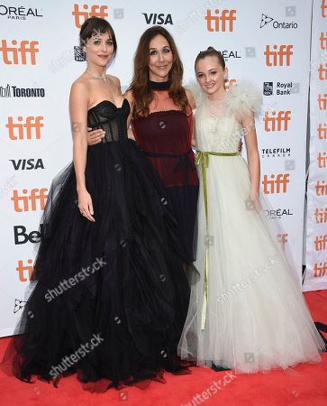 """Dakota Johnson, Gabriela Cowperthwaite, Isabella Kai. Dakota Johnson, from left, Gabriela Cowperthwaite and Isabella Kai RiceRiceRiceattend the premiere for """"The Friend"""" on day two of the Toronto International Film Festival at the Princess of Wales Theatre, in Toronto"""