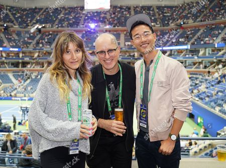 Zina Wilde, Kelly AuCoin and Daniel K. Isaac stop by the Heineken suite at the U.S. Open