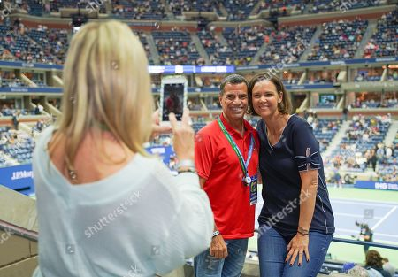 Lindsay Davenport poses with fans in the Heineken suite at the U.S. Open.