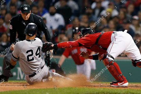 Christian Vazquez, Gary Sanchez. Boston Red Sox's Christian Vazquez, right, tags out New York Yankees' Gary Sanchez (24), who tried score on a single by Brett Gardner during the seventh inning of a baseball game in Boston