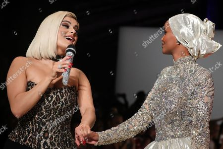 Bebe Rexha on the catwalk and Halima Aden on the catwalk