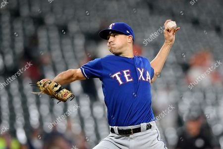 Texas Rangers starting pitcher Brock Burke delivers during the first inning of a baseball game against the Baltimore Orioles, in Baltimore