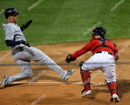 Stock Picture of New York Yankees catcher Gary Sanchez (L) of the Dominican Republic is tagged out at home plate by Boston Red Sox catcher Christian Vazquez (R) of Puerto Rico during the seventh inning of the MLB baseball game between the Boston Red Sox and the New York Yankees at Fenway Park in Boston, Massachusetts, USA, 06 September 2019.