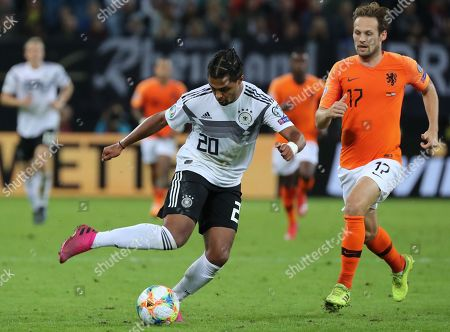 Germany's Serge Gnabry (L) in action against Netherland's Daley Blind (R) during the UEFA EURO 2020 qualifiers group C soccer match between Germany and the Netherlands in Hamburg, Germany, 06 September 2019.